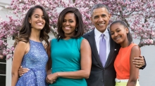 President Barack Obama, First Lady Michelle Obama, and daughters Malia and Sasha pose for a family portrait with Bo and Sunny in the Rose Garden of the White House on Easter Sunday, April 5, 2015.(Official White House Photo by Pete Souza)